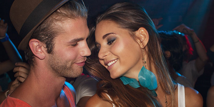 Close up of smiling couple face to face in nightclub